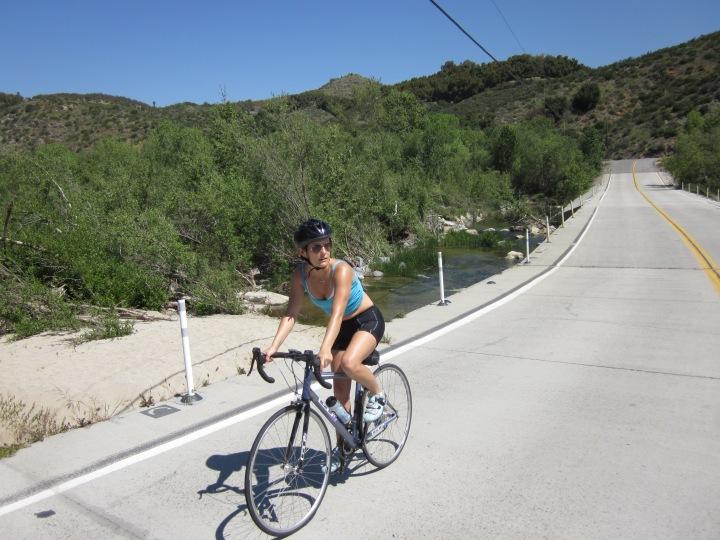 Liz bike on bridge